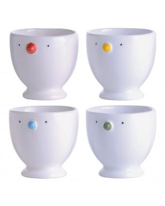 Ensemble de quatre coquetiers en porcelaine